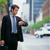 Businessman Looking at Watch    Stock Photo - Premium Rights-Managednull, Code: 700-00350884