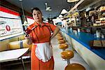 Waitress Holding Dessert in Diner
