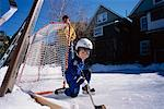 Father and Child Playing Hockey    Stock Photo - Premium Rights-Managed, Artist: Curtis R. Lantinga, Code: 700-00361756