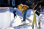 Father and Child Playing Hockey    Stock Photo - Premium Rights-Managed, Artist: Curtis R. Lantinga, Code: 700-00361758