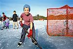 Children Playing Hockey    Stock Photo - Premium Rights-Managed, Artist: Curtis R. Lantinga, Code: 700-00361763