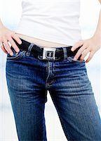 Woman Using Seatbelt as Belt    Stock Photo - Premium Royalty-Freenull, Code: 600-00362039