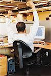 Businessman Cheering in Office