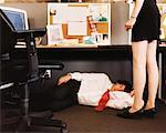Manager Watching Sleeping Office Worker    Stock Photo - Premium Rights-Managed, Artist: Noel Hendrickson, Code: 700-00364012