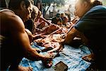 Men Cutting up Pig for Ceremony Penestanan, Bali. Indonesia    Stock Photo - Premium Rights-Managed, Artist: Carl Valiquet, Code: 700-00364304