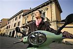 Woman on scooter in Milan/ Stock Photo - Premium Royalty-Free, Artist: Mike Randolph, Code: 604-00365387