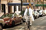 Doctor Riding Bicycle    Stock Photo - Premium Rights-Managed, Artist: Steve Prezant, Code: 700-00366151