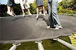 Children on trampoline Stock Photo - Premium Royalty-Free, Artist: