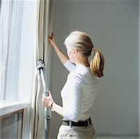 Woman Cleaning Curtains    Stock Photo - Premium Rights-Managednull, Code: 700-00424445