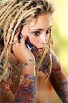 Teen Girl with Dreads and Cell Phone    Stock Photo - Premium Rights-Managed, Artist: Brian Pieters, Code: 700-00424660