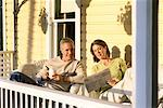 Couple Reading on Porch