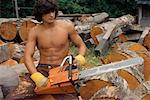 Man Using Chainsaw    Stock Photo - Premium Rights-Managed, Artist: Richard Smith, Code: 700-00430157
