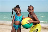 Boy and Girl Playing on Beach    Stock Photo - Premium Rights-Managednull, Code: 700-00430896