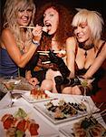 Friends Eating Sushi    Stock Photo - Premium Rights-Managed, Artist: Dazzo, Code: 700-00439097
