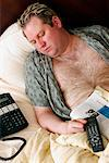 Man Passed Out in bed    Stock Photo - Premium Rights-Managed, Artist: Dazzo, Code: 700-00439577