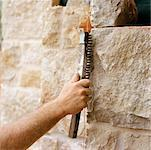 Hand of Mason Working on Stone Wall