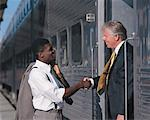 businessmen shaking hands standing in a train Stock Photo - Premium Royalty-Free, Artist: Transtock, Code: 618-00445865