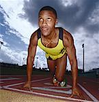 low angle view of a young male athlete starting a race Stock Photo - Premium Royalty-Freenull, Code: 618-00448330