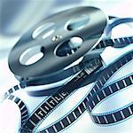 close-up of a reel of film unraveled from a spool Stock Photo - Premium Royalty-Freenull, Code: 618-00450673