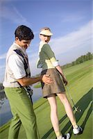 Man Groping Woman on Golf Course    Stock Photo - Premium Rights-Managednull, Code: 700-00453056