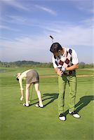 Man Checking Out Woman at Golf Course    Stock Photo - Premium Rights-Managednull, Code: 700-00453071