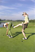 Woman Kicking Man at Golf Course    Stock Photo - Premium Rights-Managednull, Code: 700-00453073