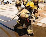 Firefighter Pulling Hose    Stock Photo - Premium Rights-Managed, Artist: Steve Craft, Code: 700-00453242