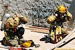 Firefighters Putting on Equipment    Stock Photo - Premium Rights-Managed, Artist: Steve Craft, Code: 700-00453243