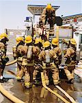 Firefighters Getting Equipment from Fire Truck    Stock Photo - Premium Rights-Managed, Artist: Steve Craft, Code: 700-00453249