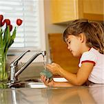 Girl Soaking Sponge in Sink    Stock Photo - Premium Rights-Managed, Artist: Marnie Burkhart, Code: 700-00453458