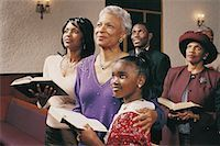 Family Standing in Church Pews Holding Bibles and Listening to a Service Stock Photo - Premium Royalty-Freenull, Code: 613-00455836