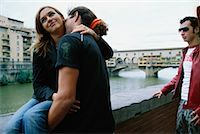 Couple Kissing While Man Watches    Stock Photo - Premium Rights-Managednull, Code: 700-00458299