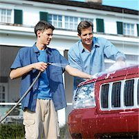 portrait of a father and son washing the car together Stock Photo - Premium Royalty-Freenull, Code: 618-00459192