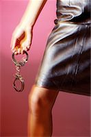 blurred view of woman holding handcuffs Stock Photo - Premium Royalty-Freenull, Code: 618-00462935