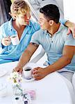 a young gay couple drinking coffee Stock Photo - Premium Royalty-Free, Artist: icons                         , Code: 618-00463135