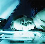 toned shot of a young woman laying her face down on a photocopy machine Stock Photo - Premium Royalty-Free, Artist: Masterfile, Code: 618-00466488