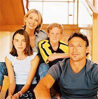 preteen family - portrait of a family Stock Photo - Premium Roya