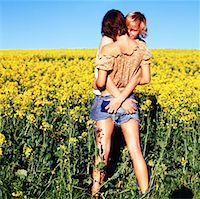 view of a man hugging a woman and grabbing her behind in a field Stock Photo - Premium Royalty-Freenull, Code: 618-00468643
