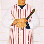 close-up of a butchers hands holding meat knives Stock Photo - Premium Royalty-Free, Artist: Masterfile, Code: 618-00468879