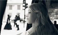 Girl Looking Out at Street, Mayfair, London, England    Stock Photo - Premium Rights-Managednull, Code: 700-00476622