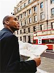 Man Holding Map, London, England    Stock Photo - Premium Rights-Managed, Artist: Janet Bailey, Code: 700-00477754