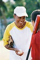 Mother and Son Playing Baseball    Stock Photo - Premium Rights-Managednull, Code: 700-00477804