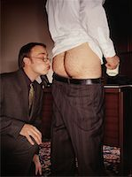 Businessman Kissing Butt    Stock Photo - Premium Rights-Managednull, Code: 700-00477903