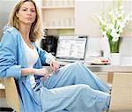 Portrait of Woman Relaxing at Home    Stock Photo - Premium Rights-Managed, Artist: Philip Rostron, Code: 700-00477969