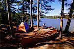 Man Camping at Pinetree Lake, Algonquin Provincial Park, Ontario, Canada