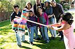 Family Playing with Pinata in Backyard    Stock Photo - Premium Rights-Managed, Artist: David Schmidt, Code: 700-00481631