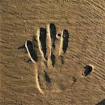Close-up shot of a handprint in the sand Stock Photo - Premium Royalty-Free, Artist: Robert Harding Images, Code: 618-00485961