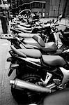 Motorbikes and scooters parked on the sidewalk (black and white) Stock Photo - Premium Royalty-Freenull, Code: 618-00486152