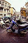View of motorbikes parked outside a building Stock Photo - Premium Royalty-Freenull, Code: 618-00486154