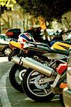Motorbikes parked on the street Stock Photo - Premium Royalty-Freenull, Code: 618-00486539